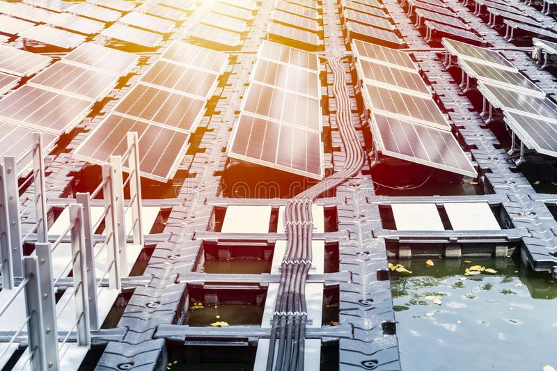 Floating solar farm or FPV array. Of solar panels on water lake river pond stock image