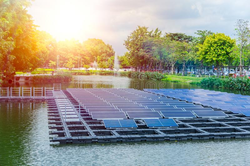 Floating solar panels or solar cell clean energy technology. Floating solar panels or solar cell Platform on the water lake pond for saving energy technology stock photos