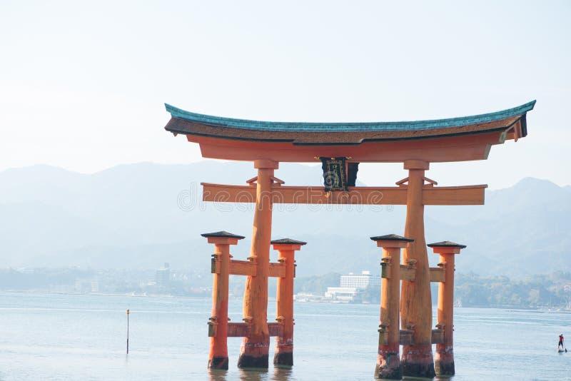 Floating torii gate of Itsukushima Shrine at Miyajima island. Hiroshima, Japan. Japanese characters mean `itsukushima shrine royalty free stock images