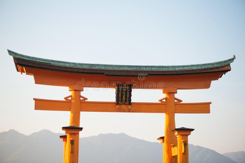 Floating torii gate of Itsukushima Shrine at Miyajima island. Hiroshima, Japan. Japanese characters mean `itsukushima shrine stock photos