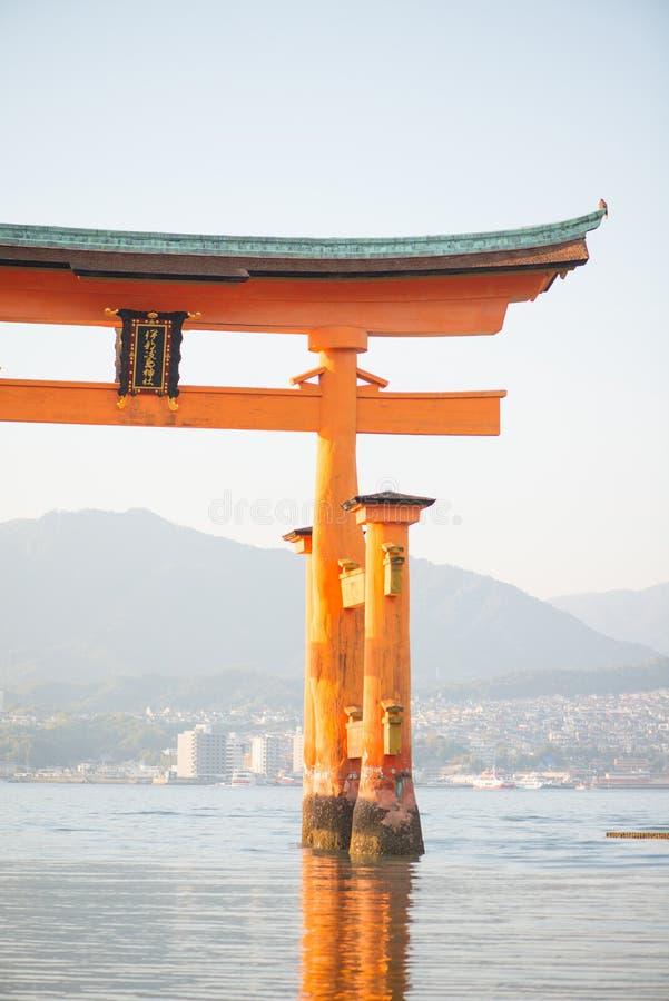 Floating torii gate of Itsukushima Shrine at Miyajima island. Hiroshima, Japan. Japanese characters mean `itsukushima shrine royalty free stock image