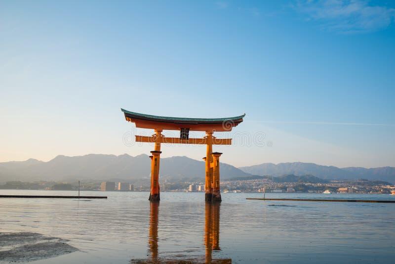 Floating torii gate of Itsukushima Shrine at Miyajima island. Hiroshima, Japan. Japanese characters mean `itsukushima shrine stock photography