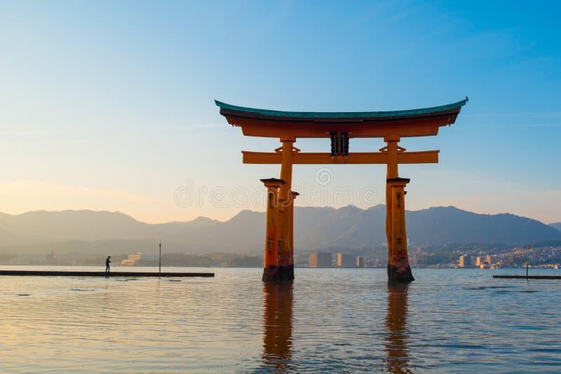 Floating torii gate of Itsukushima Shrine at Miyajima island. Hiroshima, Japan. Japanese characters mean `itsukushima shrine stock images