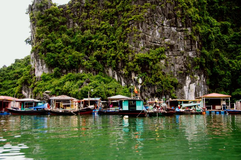 Floating village in halong bay vietnam. A floating village in the picturesque world heritage area of halong bay, vietnam stock images