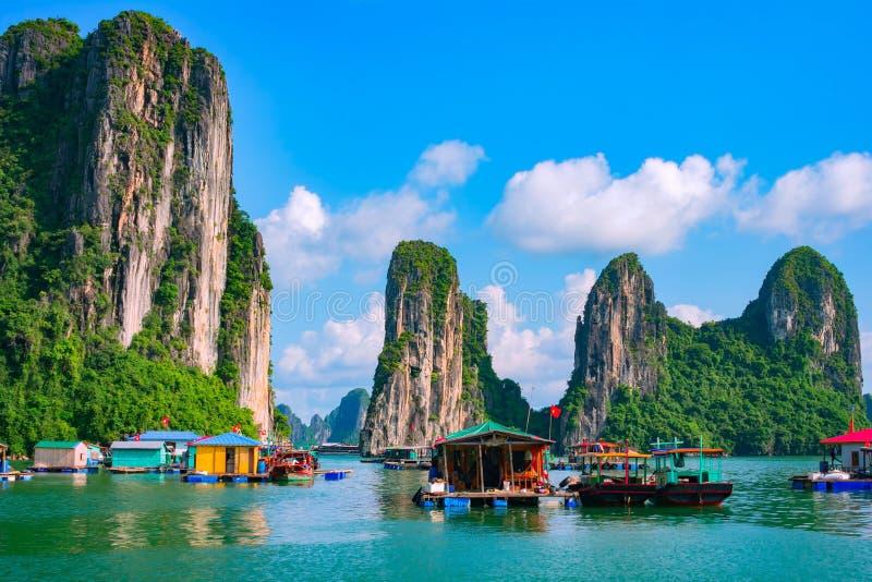 Floating village, rock island, Halong Bay, Vietnam. Floating fishing village and rock island in Halong Bay, Vietnam, Southeast Asia. UNESCO World Heritage Site