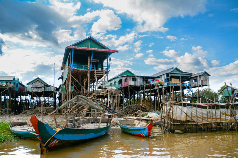 Floating village on Tonle Sap. A floating village and boats on the Tonlé Sap lake and river in Cambodia stock photo