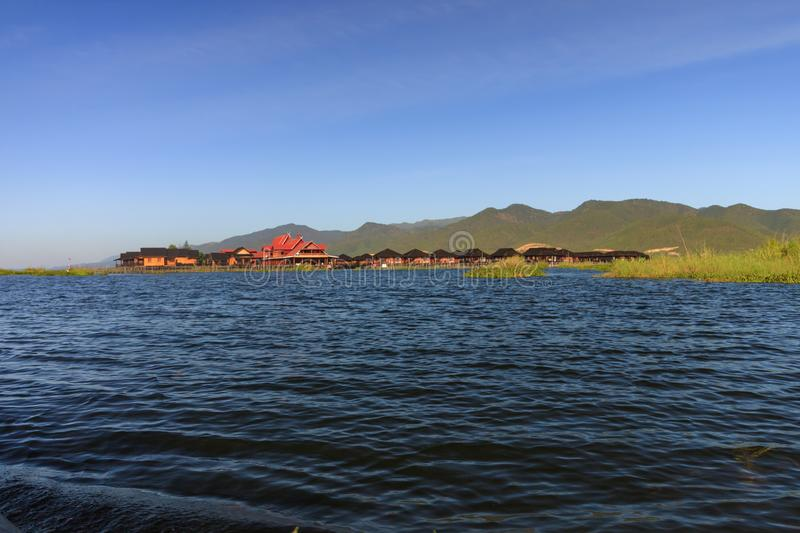 Floating villages are found all over the Inle Lake located in Myanmar stock photography