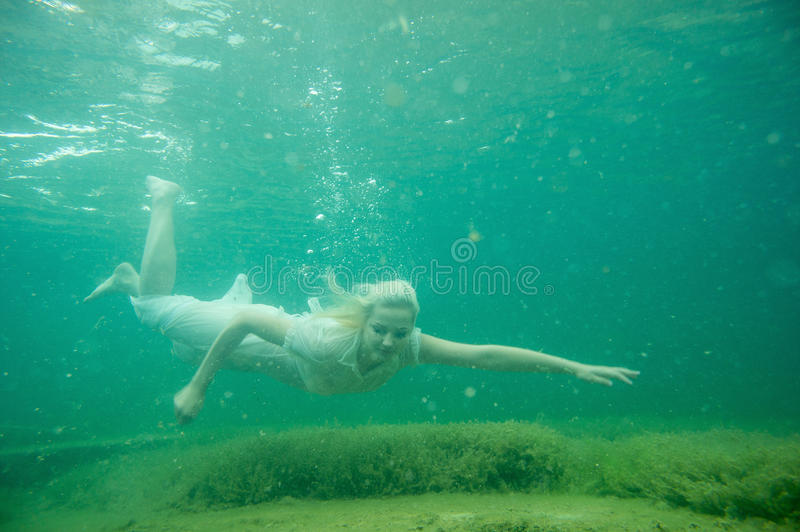 Download A Floating Woman. Underwater Portrait. Girl In White Dress Swimming In The Lake. Green Marine Plants, Water Stock Image - Image of floating, ocean: 93324601