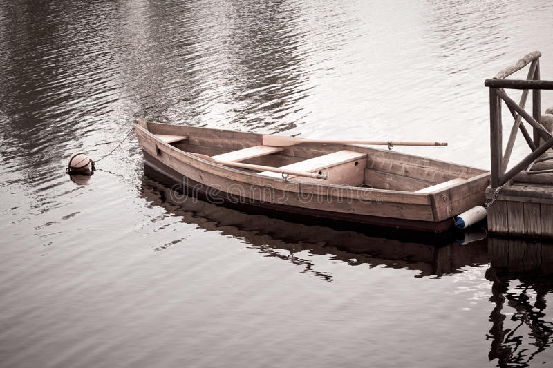 Download Floating Wooden Boat With Paddles Royalty Free Stock Image - Image: 28835206