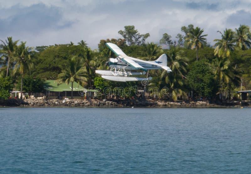Floatplane landing in tropical Fiji stock images