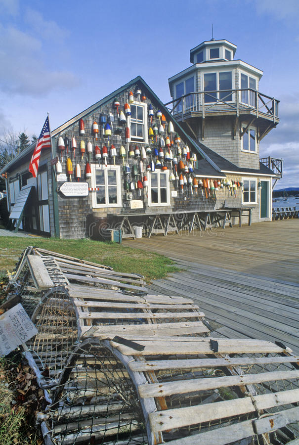 Floats from fishing nets hang on the side of a lighthouse in Stonington, Mount Desert Island, Maine royalty free stock image