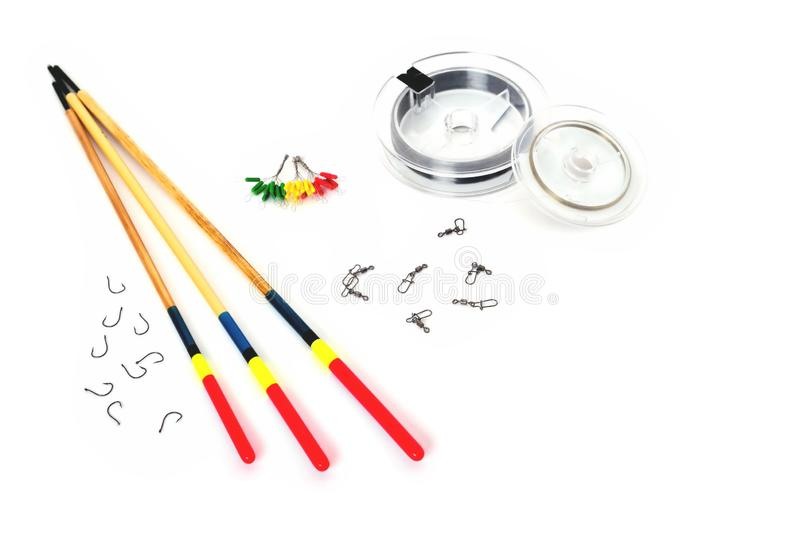 Floats, hooks, fishing line and fishing accessories on a white background. Close-up royalty free stock image
