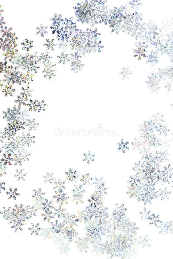 Floco de neve do Sparkle confetti sobre fundo branco foto de stock