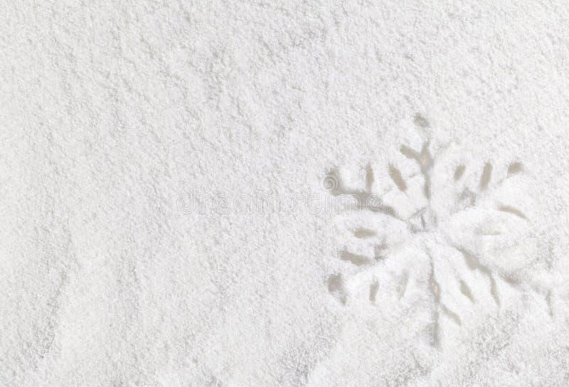 Floco de neve na neve imagens de stock