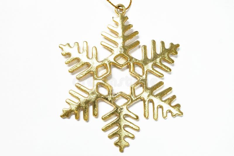 Flocon d'or de neige sur le fond blanc images libres de droits