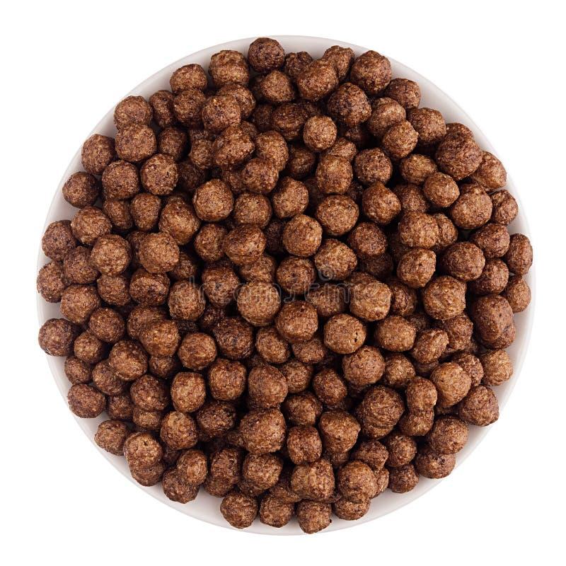 Flocons d'avoine de boules de chocolat dans la cuvette blanche d'isolement, vue supérieure céréales images libres de droits