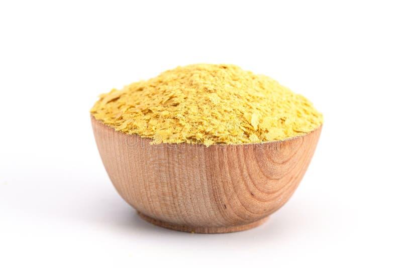 Flocons de levure nutritionnelle jaune un substitut de fromage et assaisonnement pour des régimes de Vegan photographie stock