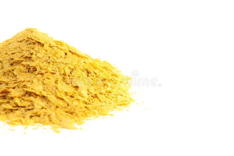 Flocons de levure nutritionnelle jaune un substitut de fromage et assaisonnement pour des régimes de Vegan photo libre de droits
