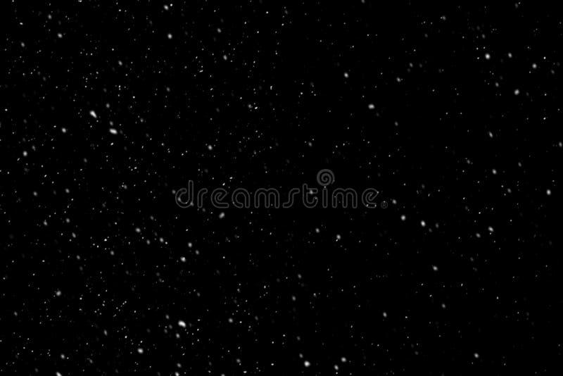 Flocons de neige blancs sur un fond noir photos libres de droits