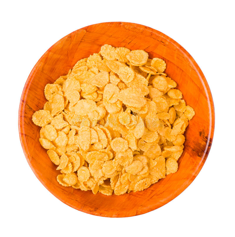 Flocos de milho em uma placa fotografia de stock
