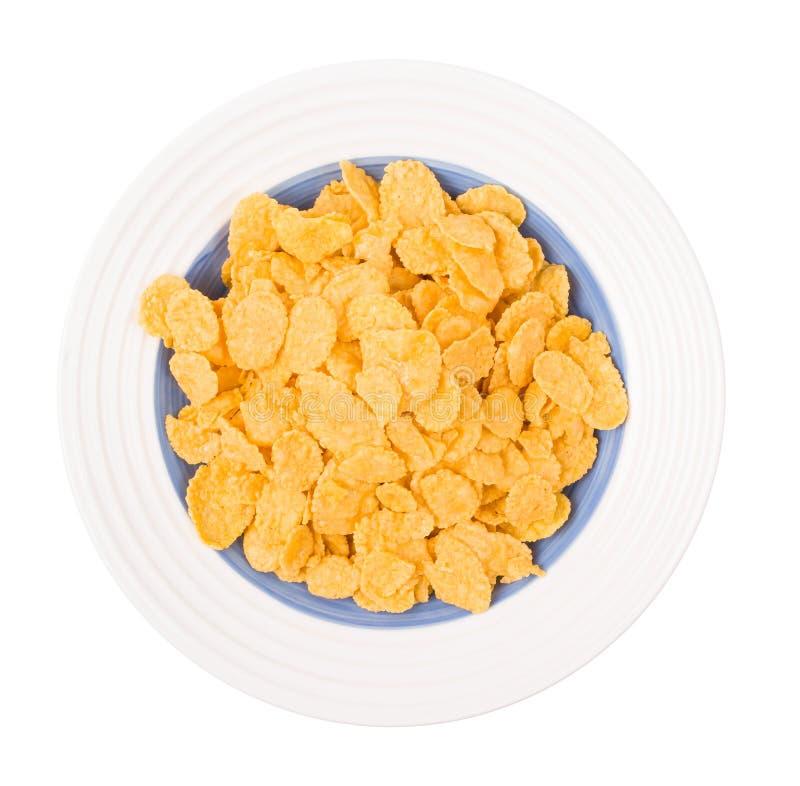 Flocos de milho em uma placa imagem de stock