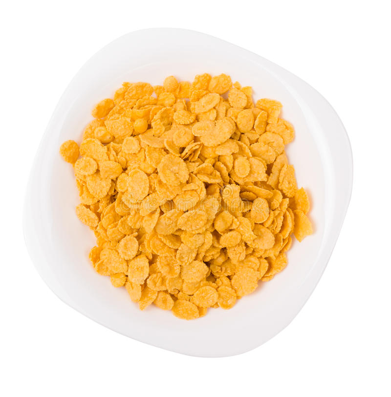 Flocos de milho em uma placa fotos de stock royalty free