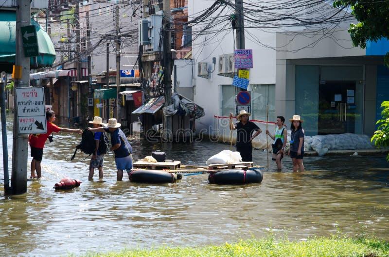 Flood in Bangkok, Thailand. BANGKOK THAILAND – NOVEMBER 13 : the victims of flood waiting for higher vehicle in Phahon Yothin Road November 13, 2011 in stock photography