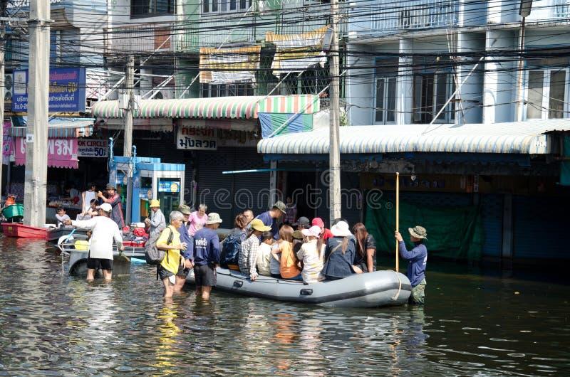 Flood in Bangkok, Thailand. BANGKOK THAILAND – NOVEMBER 13 : the victims of flood waiting for higher vehicle in Phahon Yothin Road November 13, 2011 in stock photo