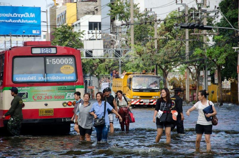 Flood in Bangkok, Thailand. BANGKOK THAILAND – NOVEMBER 13 : the victims of flood waiting for higher vehicle in Phahon Yothin Road November 13, 2011 in royalty free stock images