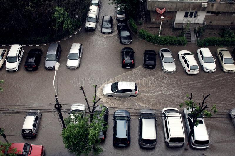 Flood. Cars passing throgh big water flood in Bucharest, after the big rain. Picture taken in 05.05.2014 royalty free stock images