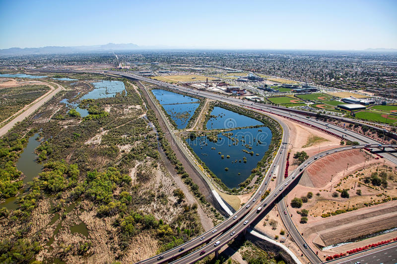 Flood control, freeways and bike path stock images