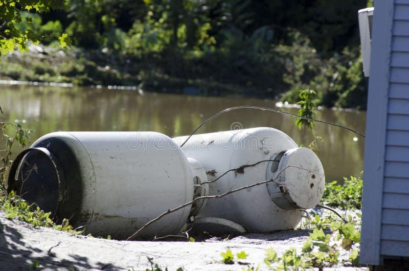 Flood Damage Northfield Vermont : Hurricane Irene. Mark Collier / Staff Photo Northfield Vermont propane tanks littered the banks of the Dog River on River treet stock photography