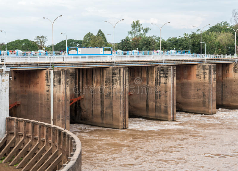 Flood gate of the small concrete dam. royalty free stock photo