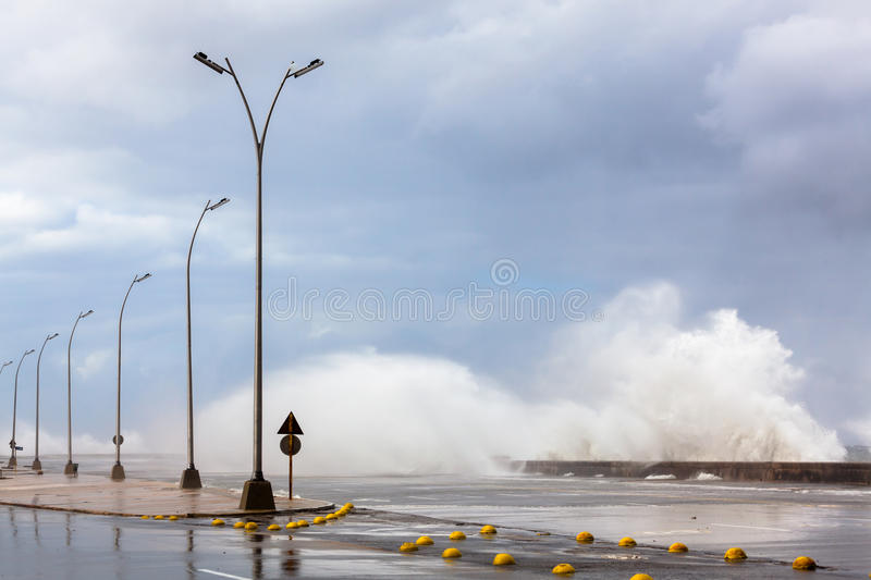 Flood in Havana, Cuba. The storm was so strong that the stone parapet could not hold back the assault of giant waves. As a result, parts of Havana, the capital stock photo