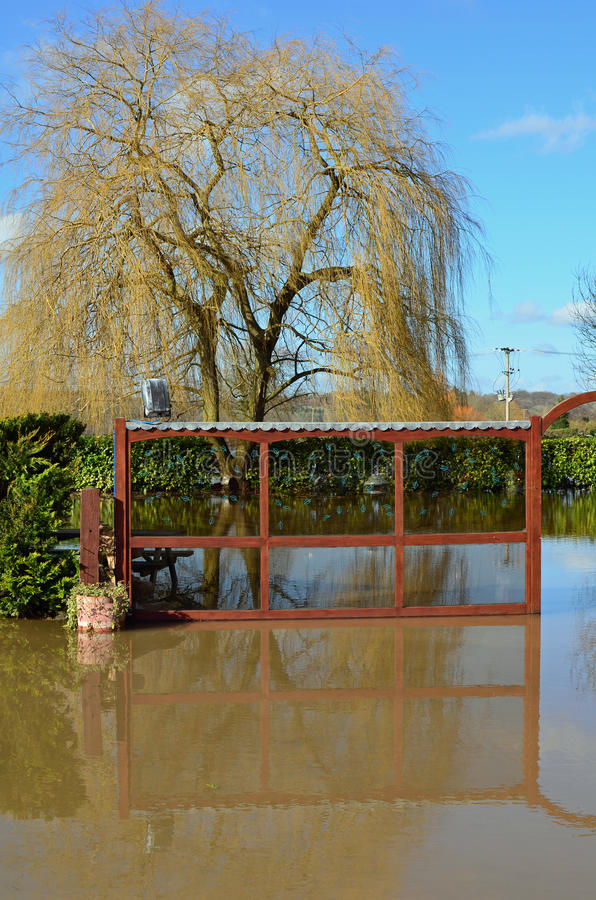 Flood at Pub Restaurant Car Park, Romsey, Hants. Flooding at Pub Restaurant Car Park, Romsey, Hampshire England taken on 16th February 2014. The River Test had stock image