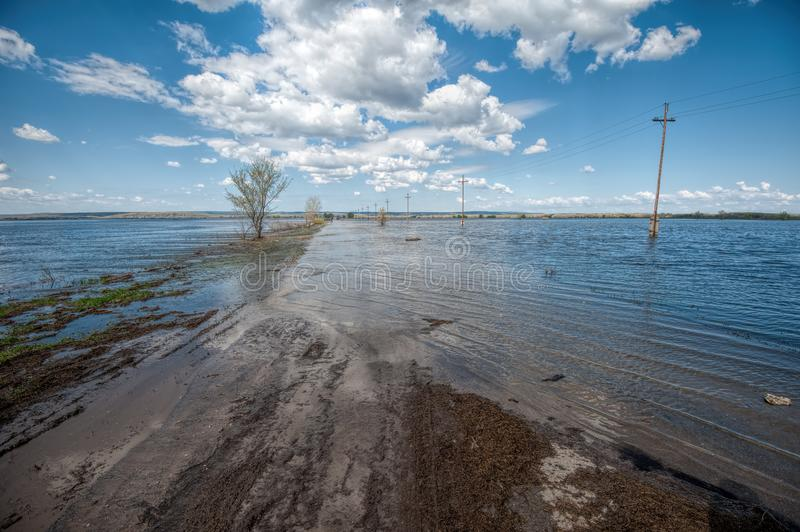 The flood of the river Don. Dangerous water level on the road towards Tryokhostrovskaya ferry station. royalty free stock photos