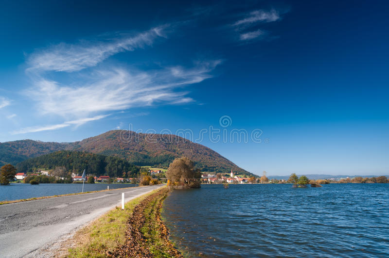 Flood. Road in flooded fields. In Slovenia stock photo