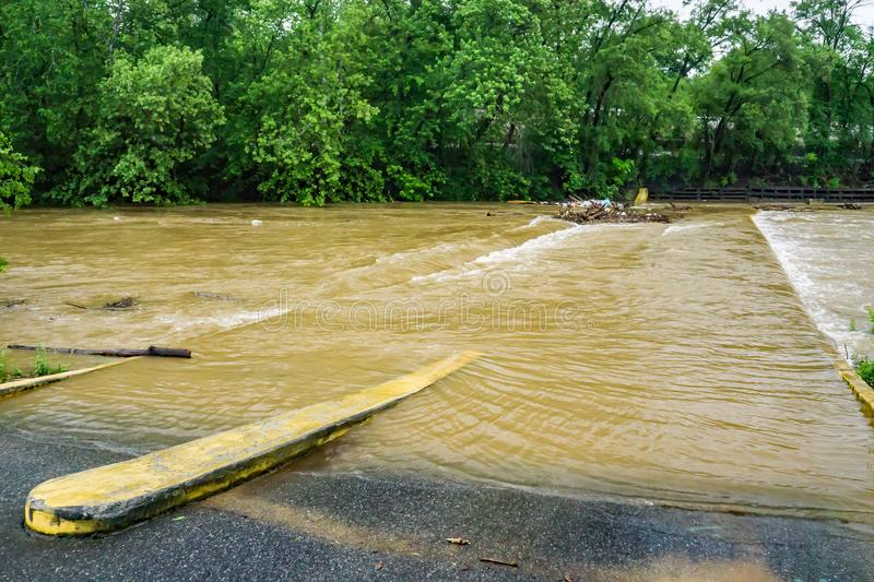 Flood Waters Covering Bridge – May 18th, 2018. A view of the bridge on Wiley Drive covered by spring flood waters of the Roanoke River located in Smith royalty free stock photos