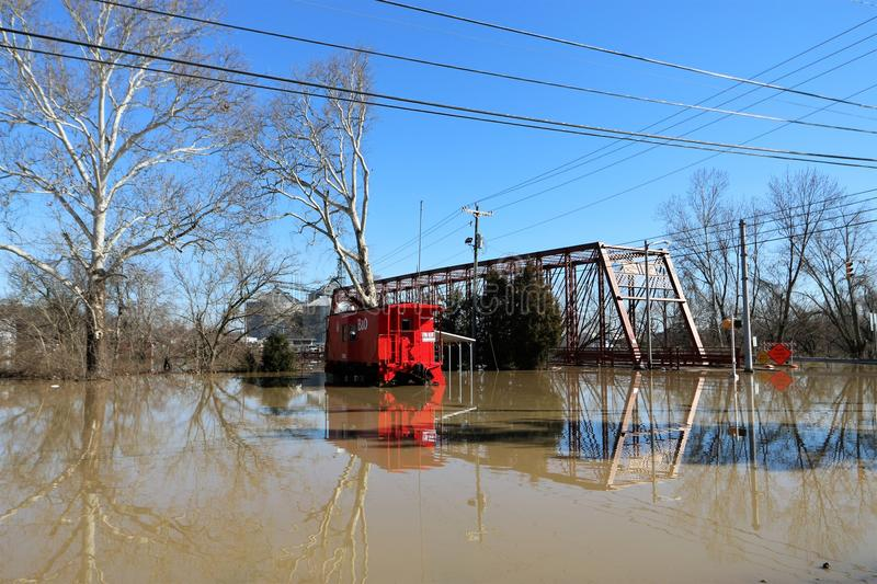 Flood waters over bridge and boxcar in Aurora, Indiana. February 2018 flooding of Aurora, Indiana from the Ohio River. Flood waters over bridge and boxcar stock photography