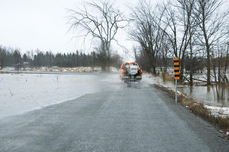 Flood waters over roadway following heavy rains stock photography