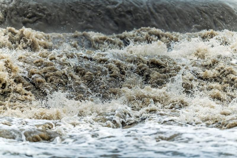 Flood Wave Water Disaster. Rushing Dirty Flood Water Closeup Photo. State of Emergency stock photography