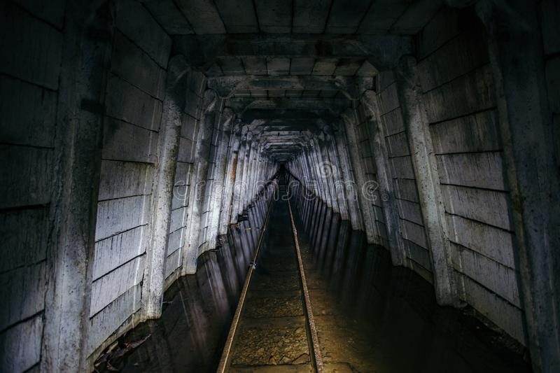 Flooded abandoned uranium mine with rusty railway stock photo