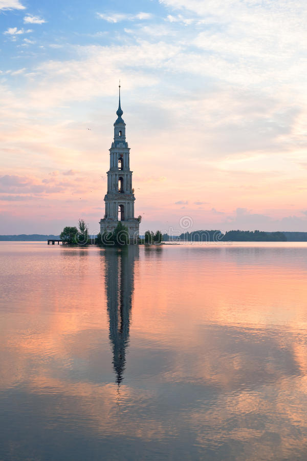 Flooded belltower in Kalyazin at sunrise royalty free stock photography