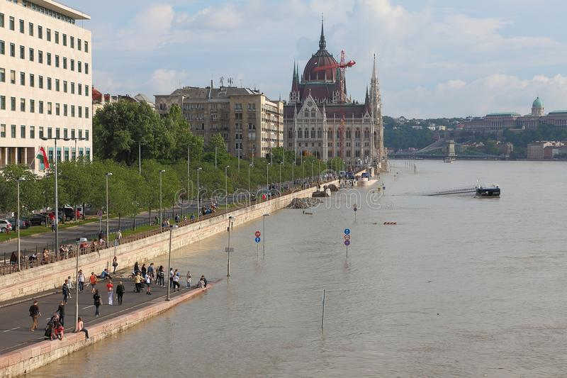 Flooded Budapest. BUDAPEST, HUNGARY - JUNE 6: People at the flooding river Danube, June 6th 2013. Record breaking water level is expected in a few days stock images
