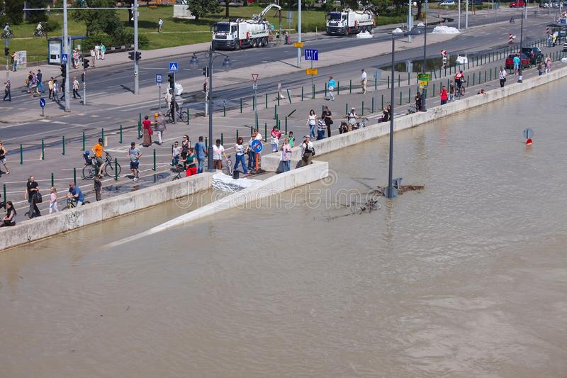 Flooded Budapest Street. BUDAPEST, HUNGARY - JUNE 6: People at the flooding river Danube, June 6th 2013. Record breaking water level is expected in a few days royalty free stock photos