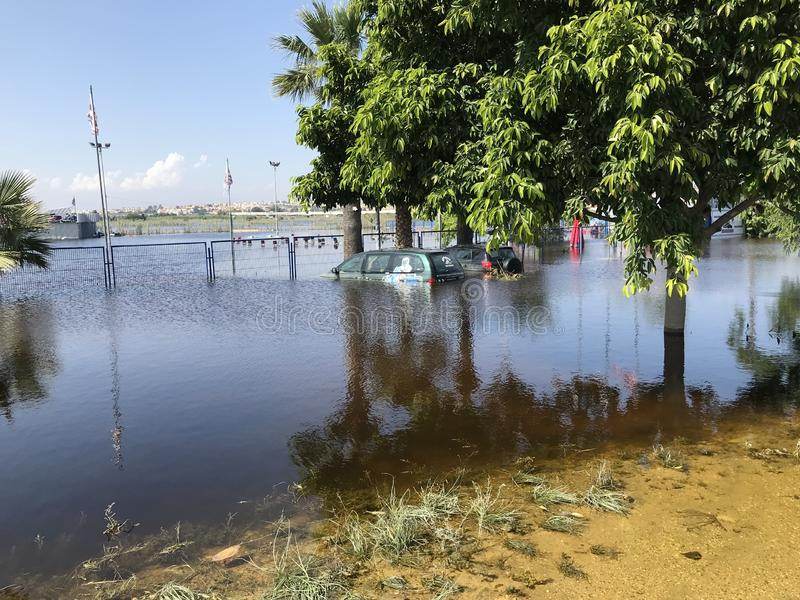 Flooded Cars in the Parking Road. Deep Waters. Flooding Nature After Heavy Rainy Day. Global Warming. stock photography