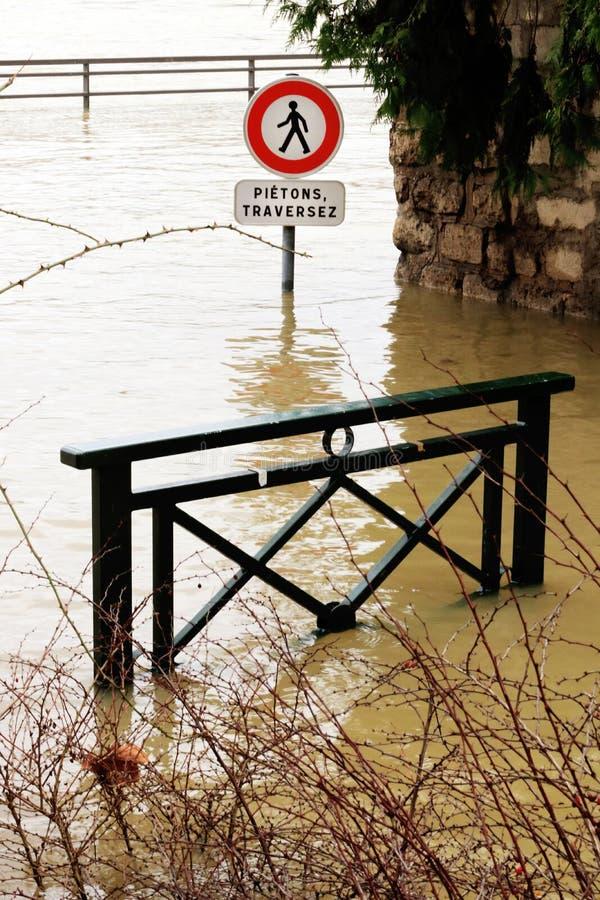 Flooded cross road warning sign Seine River banks damages Paris stock photos