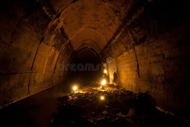 Flooded by dirty industrial wastewater sewage collector. Sewer tunnel under city full of garbage. Flooded by dirty industrial wastewater sewage collector. Sewer royalty free stock photos