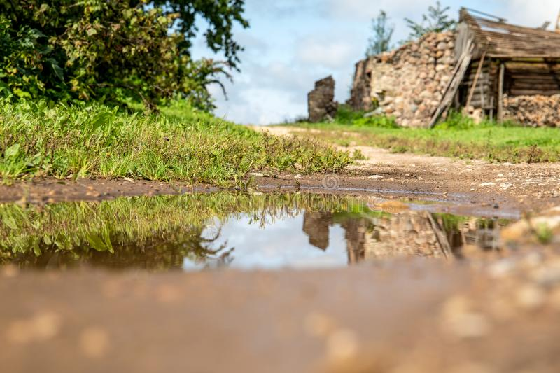 Flooded, muddy country road after rainfall and storm. Natural disaster and consequences of global warming royalty free stock photos