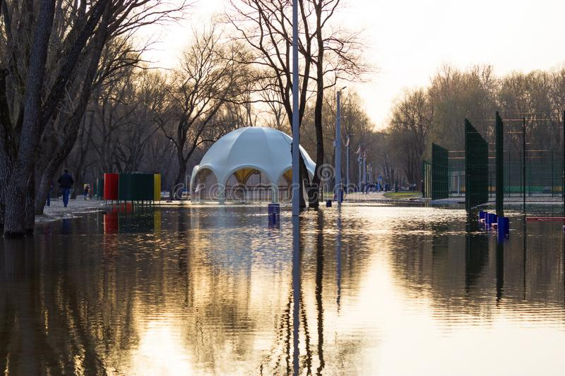 Flooded park, beach and UFO-shaped bar royalty free stock photography